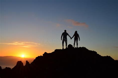 Silhouettes Of Romantic Couple Standing Together Stock