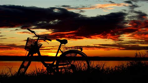 Bicycle sunset sunrise sky clouds wallpaper | 1920x1080