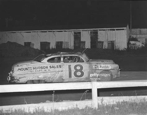 Arden Mounts sits in his Hudson Hornet awaiting assistance